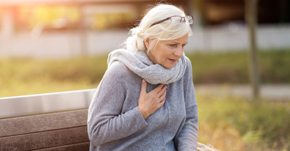 Woman with heartburn.